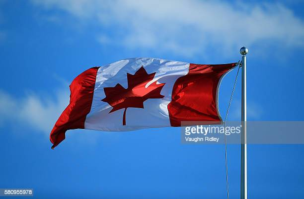 Canada flag flies in the wind on Centre Court during Day 1 of the Rogers Cup at the Aviva Centre on July 25 2016 in Toronto Ontario Canada