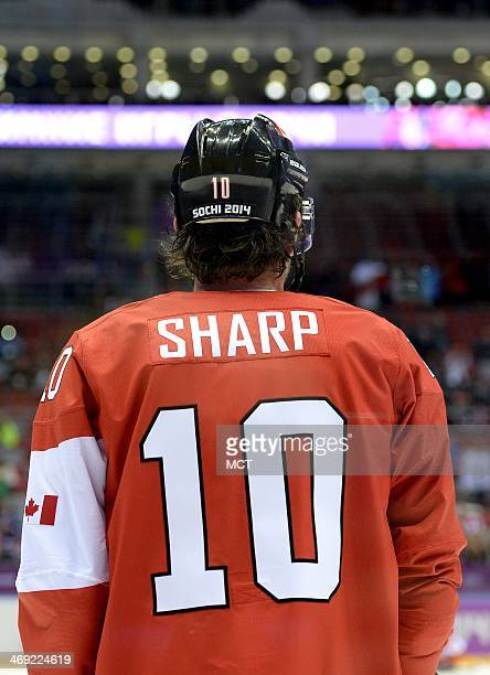 Canada forward Patrick Sharp appears from behind before a men's hockey game against Norway at the Bolshoy Ice Dome during Winter Olympics in Sochi...