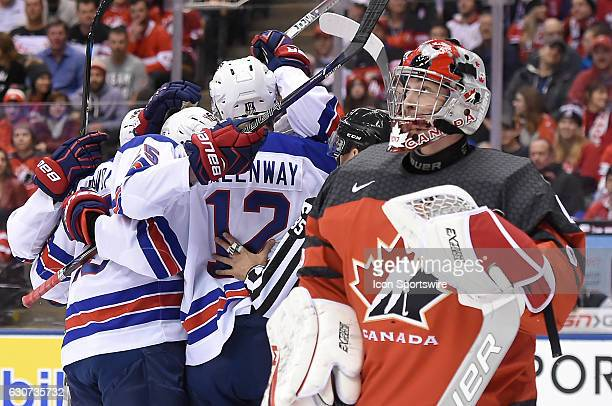 Canada goalie Connor Ingram looks at the scoreboard as USA players celebrate a goal by forward Colin White during the first period at the World...