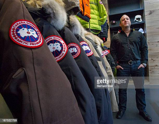 Canada Goose president and CEO Dani Reiss is framed by coats in a display at the main office