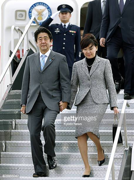 OTTAWA Canada Japanese Prime Minister Shinzo Abe and his wife Akie arrive at an international airport in Ottawa on Sept 23 for a fiveday visit to...