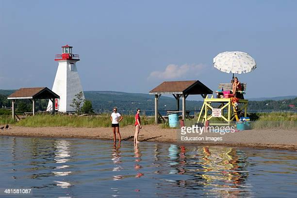 Canada Nova Scotia Cape Breton Baddeck Bras dOr Lake lighthouse with beach lifeguard
