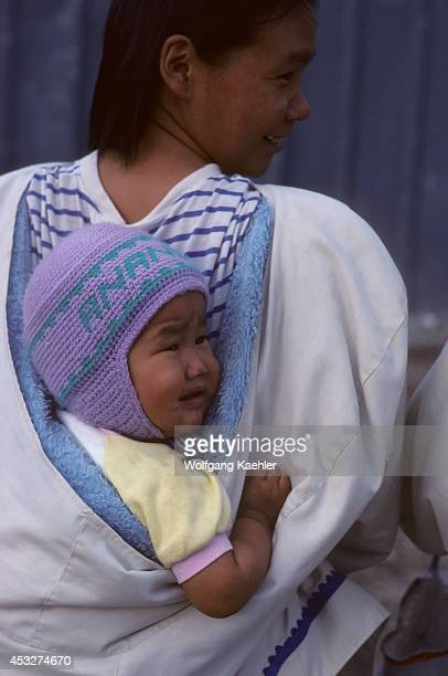 Canada Nunavut Arviat Village Scene Baby Carried Traditionally Onback