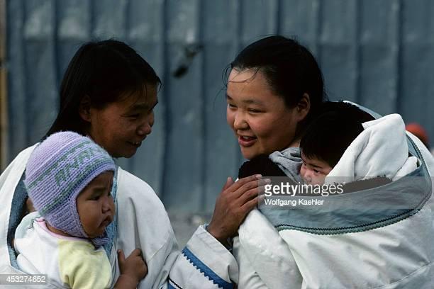 Canada Nunavut Arviat Village Scene Women Looking At Babies