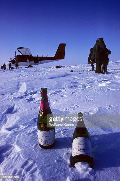Canada Nunavut At The North Pole Twin Otter With Two Bottles Of Cham Pagne In Foreground