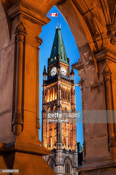Canada, Ontario, Ottawa, Parliament Hill, Illuminated Peace Tower seen through lancet arch