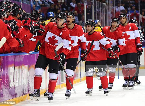 Canada players celebrate after teammate Jonathan Toews of Canada scores the opening goal in the first period during the Men's Ice Hockey Gold Medal...