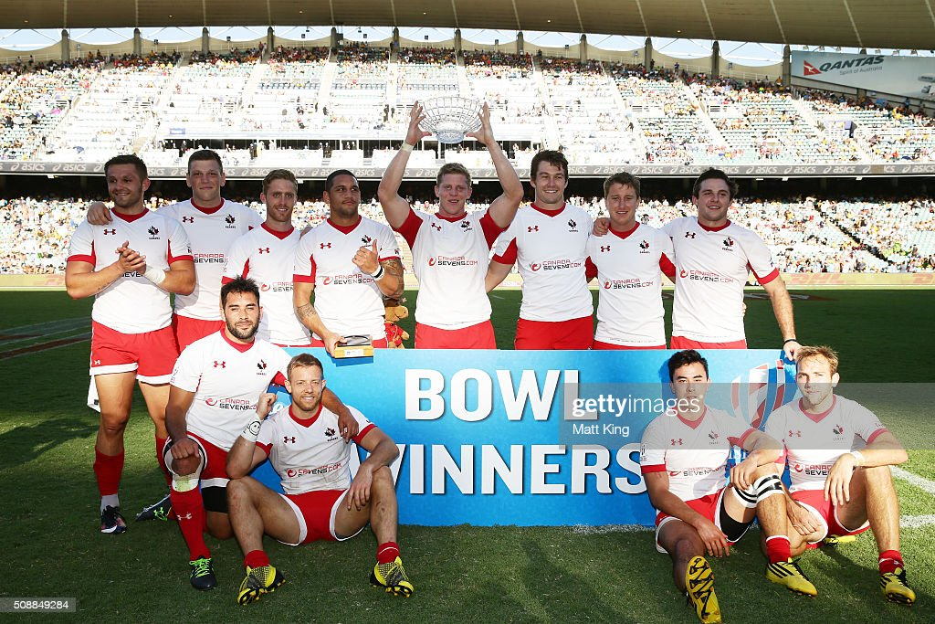 Canada pose with the winners trophy after winning the 2016 Sydney Sevens Bowl Final match against Samoa at Allianz Stadium on February 7, 2016 in Sydney, Australia.