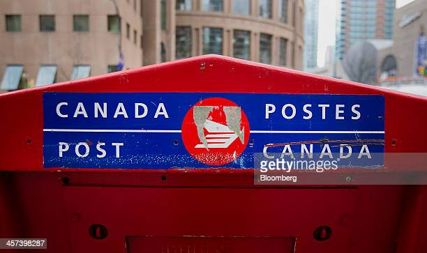 A Canada Post outlet stands in Vancouver British Columbia Canada on Monday Dec 16 2013 Canada Post announced that it plans to end home delivery in...