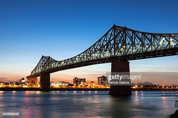 Canada, Quebec, Montreal, St. Helens Island, Illuminated Jacques Cartier Bridge against sky
