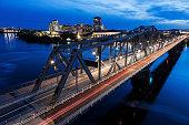 Canada, Quebec, Ottawa, Alexandra Bridge and river bank at dusk