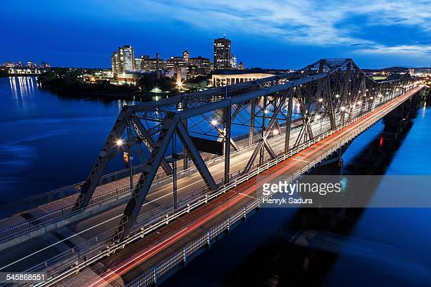 Canada, Quebec, Ottawa, Alexandra Bridge and river bank at dusk