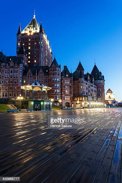 Canada, Quebec, Quebec City, Illuminated Chateau Frontenac seen from boardwalk