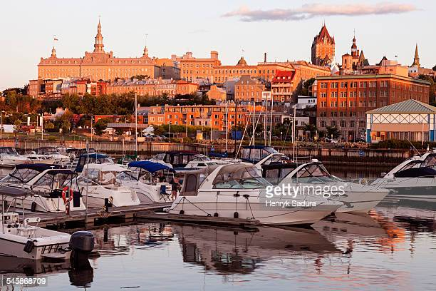 Canada, Quebec, Quebec City, Speedboats moored at marina and cityscape in background