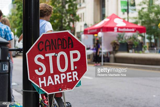 A 'Canada Stop Harper' sign board fixed on a bicycle parked beside a lamp post on a street The 'Stop Harper' campaign has been started in Canada to...