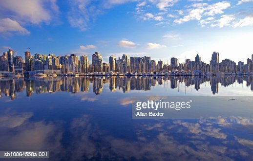 Canada, Vancouver apartment buildings reflecting in lake : Stock Photo