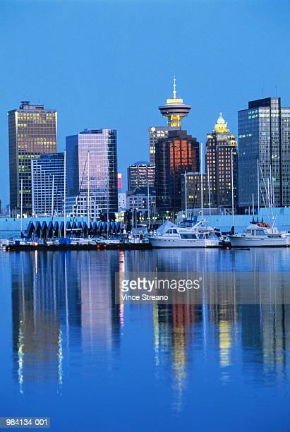 Canada, Vancouver, Stanley Park, skyline reflected in water at dusk