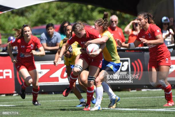 Canada vs Brazil in HSBC Canada Women's Sevens Rugby action at Westhills Stadium in Langford BC May 27 2017 / AFP PHOTO / Don MacKinnon
