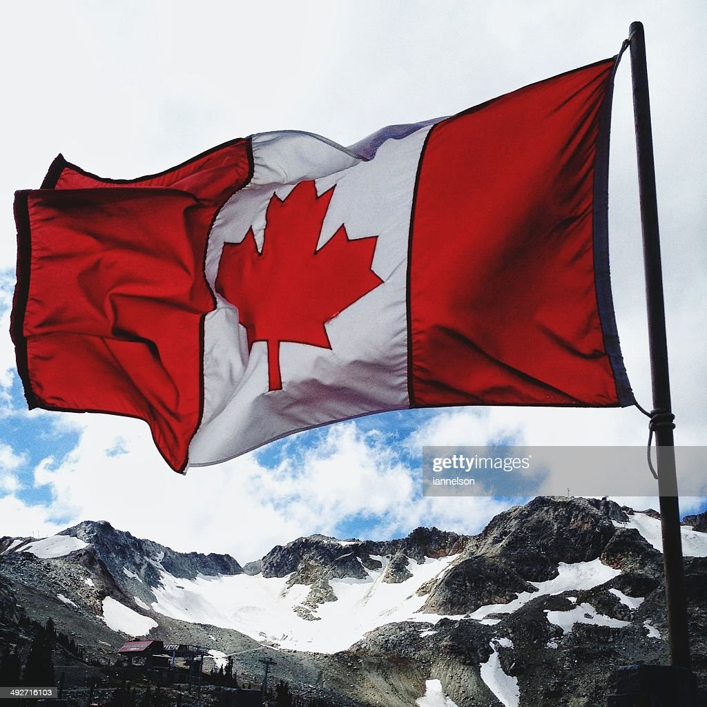 Canada, Whister, Flag of Canada waving over mountains