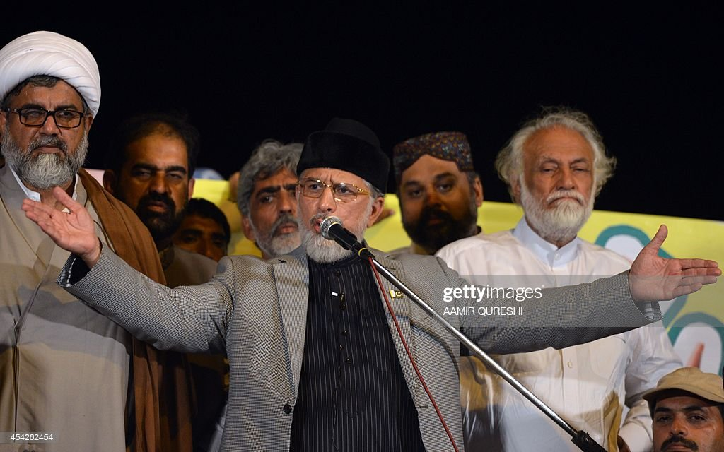 Canada-based preacher Tahir-ul-Qadri addresses Pakistani supporters during an anti-government protest in front of the Parliament in Islamabad on August 28, 2014. Pakistan's embattled prime minister said on August 27 he would not cave in to protests demanding his resignation, striking a defiant note in his first major speech since the crisis erupted two weeks ago. Nawaz Sharif told parliament his government would not be thrown off course by the demonstrations led by populist cleric Tahir-ul-Qadri and opposition leader Imran Khan -- both of whom later called off talks with the government for a second time.