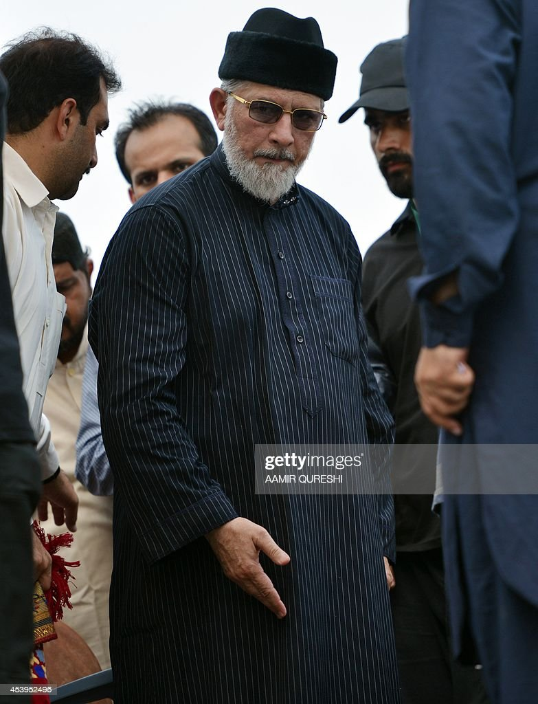 Canada-based preacher Tahir-ul-Qadri prepares to offer Friday prayers held at an anti-government protest site in front of the Parliament in Islamabad on August 22, 2014. Pakistani opposition politician Imran Khan called August 21 off talks with the government aimed at ending protests seeking the fall of the prime minister, which have unnerved the nuclear-armed nation. Khan and populist cleric Tahir-ul-Qadri have led followers protesting outside parliament for the past two days demanding Prime Minister Nawaz Sharif quit. AFP PHOTO/ Aamir QURESHI