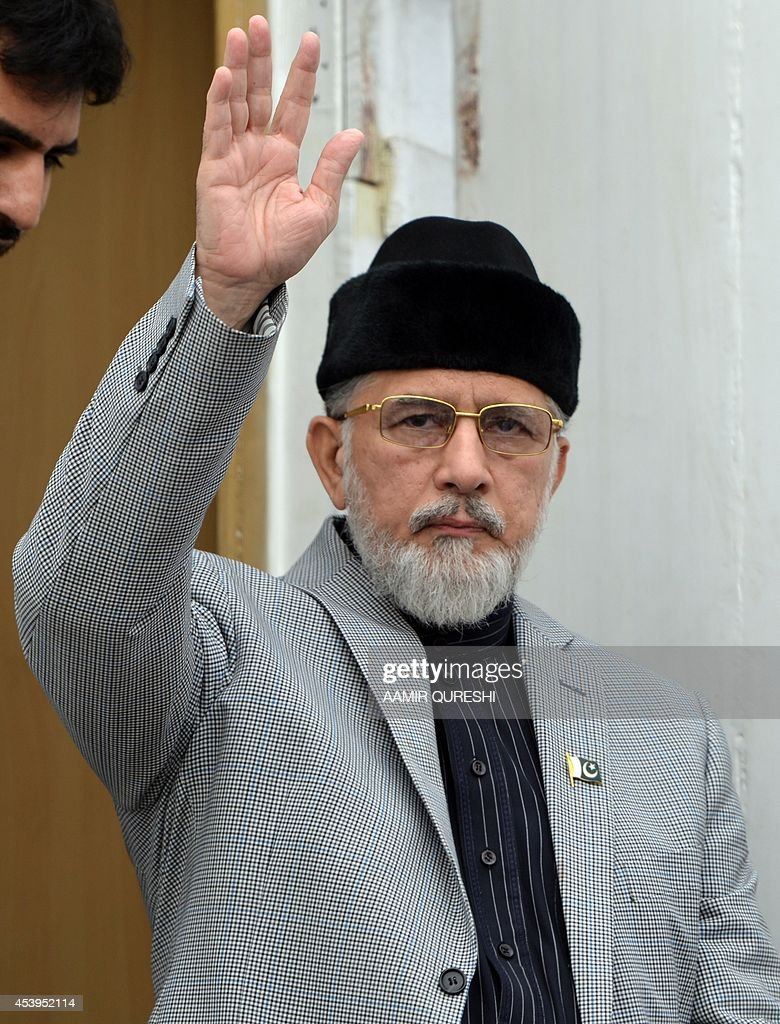 Canada-based preacher Tahir-ul-Qadri waves to Pakistani supporters as he arrives for congregational Friday prayers held at an anti-government protest site in front of the Parliament in Islamabad on August 22, 2014. Pakistani opposition politician Imran Khan called August 21 off talks with the government aimed at ending protests seeking the fall of the prime minister, which have unnerved the nuclear-armed nation. Khan and populist cleric Tahir-ul-Qadri have led followers protesting outside parliament for the past two days demanding Prime Minister Nawaz Sharif quit. AFP PHOTO/ Aamir QURESHI