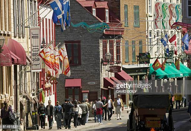 CanadaFranceQuebec BY GUILLAUME LAVALLEE flags and banners marking the 400th anniversary of the founding of Quebec City are seen over the street May...