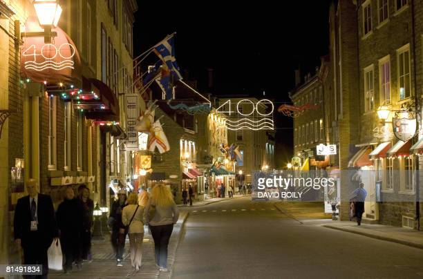 CanadaFranceQuebec BY GUILLAUME LAVALLEE Signs marking the 400th anniversary of the founding of Quebec City are seen above the popular StLouis street...