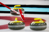 Canadain curler's broom directs play during the wheelchair curling round robin session 9 match between Canada and Korea on day five of Sochi 2014...