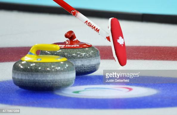 Canadain curler's broom next to a stone during the wheelchair curling round robin session 5 match between USA and Canada at the Ice Cube Curling...