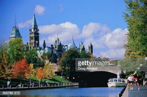 Canada,Ontario,Ottawa,Parliament Building,Rideau Canal in foreground : Stock Photo