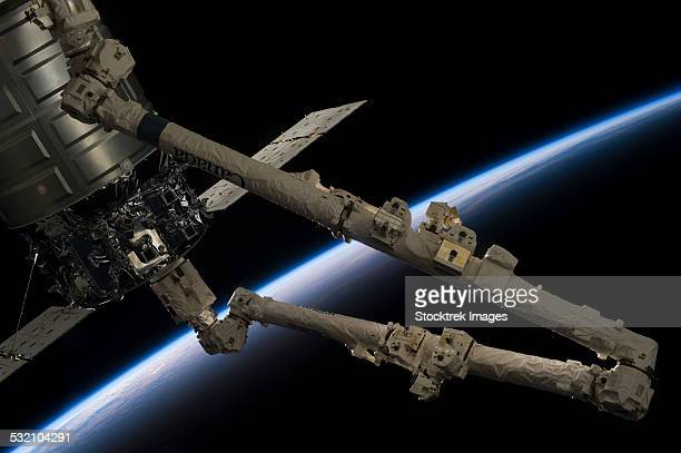 Canadarm2 robotic arm prepares to release the Cygnus spacecraft.