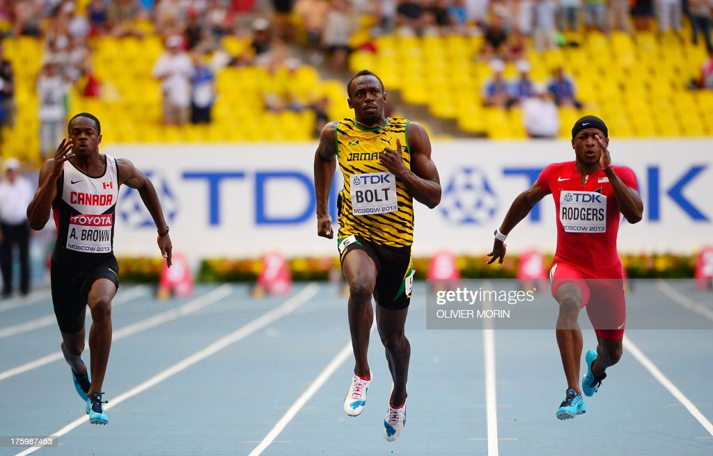 Canada's Aaron Brown, Jamaica's Usain Bolt and US Mike Rodgers race during the men's 100 metres semi-final at the 2013 IAAF World Championships at the Luzhniki stadium in Moscow on August 11, 2013. AFP PHOTO / OLIVIER MORIN