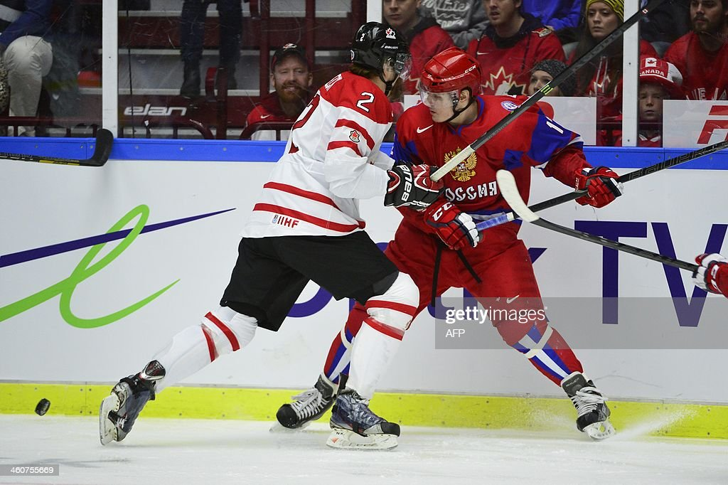 Canada's Adam Pelech (L) vies with Russia's Mikhail Grigorenko during the World Junior Hockey Championships bronze medal match between Canada and Russia at Malmo Arena in Malmo, Sweden on January 5, 2014.