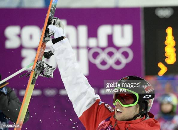 Canada's Alex Bilodeau celebrates his Gold Medal in the Men's Freestyle Skiing Moguls finals at the Rosa Khutor Extreme Park during the Sochi Winter...