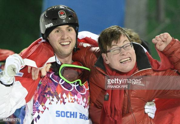 Canada's Alex Bilodeau celebrates his Gold Medal With Brother Frederic at the Men's Freestyle Skiing Moguls final at the Rosa Khutor Extreme Park...