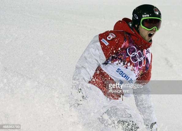 Canada's Alex Bilodeau celebrates in the Men's Freestyle Skiing Moguls finals at the Rosa Khutor Extreme Park during the Sochi Winter Olympics on...