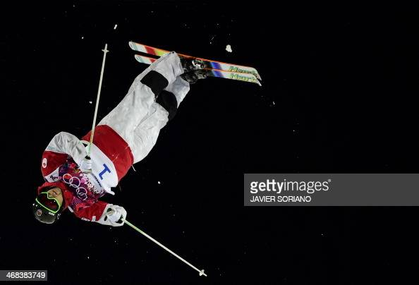 Canada's Alex Bilodeau competes in the Men's Freestyle Skiing Moguls finals at the Rosa Khutor Extreme Park during the Sochi Winter Olympics on...
