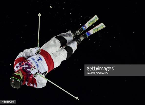 Canada's Alex Bilodeau competes in the Men's Freestyle Skiing Moguls final at the Rosa Khutor Extreme Park during the Sochi Winter Olympics on...