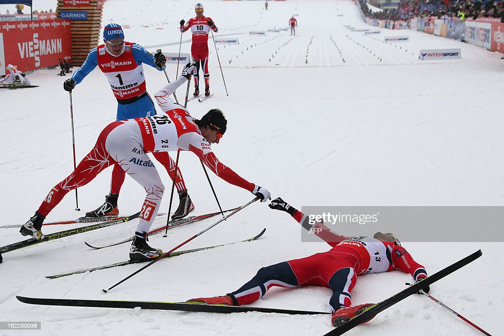 Canada's Alex Harvey (C) and Norway's Petter Northug (R) bump fists on February 21, 2013 after crossing the finish line behind Russia's Nikita Kriukov (L) at the Men's Cross Country 1.5km sprint final race of the FIS Nordic World Ski Championships at Val Di Fiemme Cross Country stadium in Cavalese, northern Italy.
