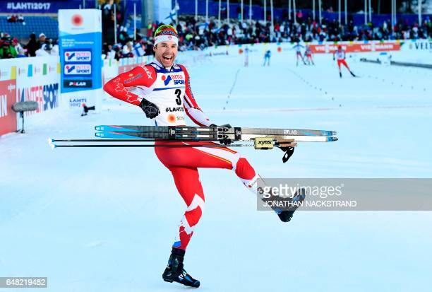 TOPSHOT Canada's Alex Harvey celebrates after winning the men's crosscountry 50 km freestyle mass start skiing competition in the FIS Nordic World...
