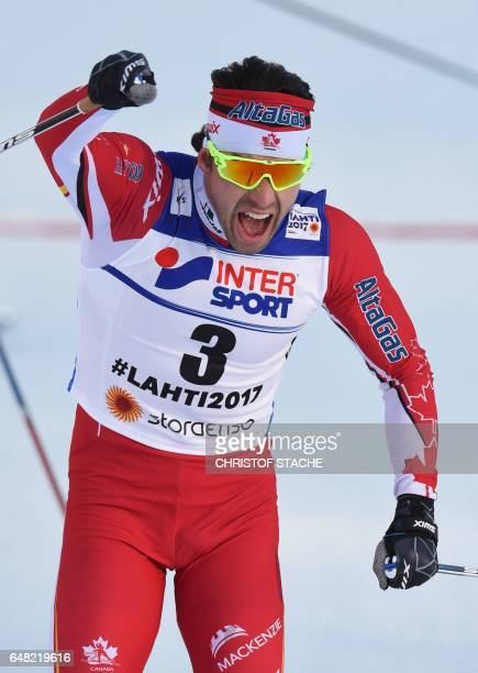 Canada's Alex Harvey celebrates winning the men's crosscountry 50 km freestyle mass start skiing competition in the FIS Nordic World Ski...
