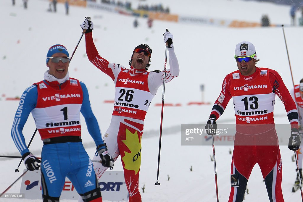 Canada's Alex Harvey (C) gestures on February 21, 2013 after crossing the finish line behind Russia's Nikita Kriukov (L) and Norway's Petter Northug at the Men's Cross Country 1.5km sprint final race of the FIS Nordic World Ski Championships at Val Di Fiemme Cross Country stadium in Cavalese, northern Italy.