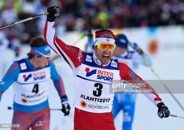 Canada's Alex Harvey reacts as he crosses the finish line of the men's crosscountry 50 km freestyle mass start skiing competition in the FIS Nordic...