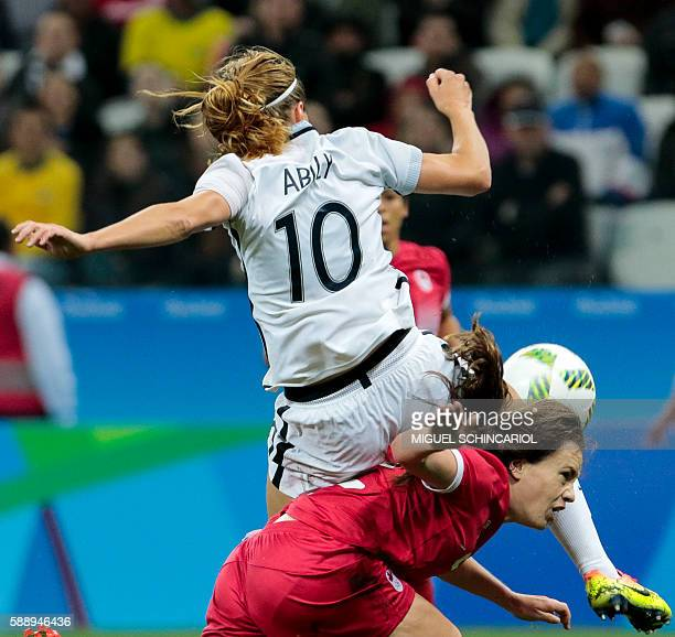 TOPSHOT Canada's Allysha Chapman and France's Camille Abily vie for the ball during their Rio 2016 Olympic Games women's football quarterfinal match...