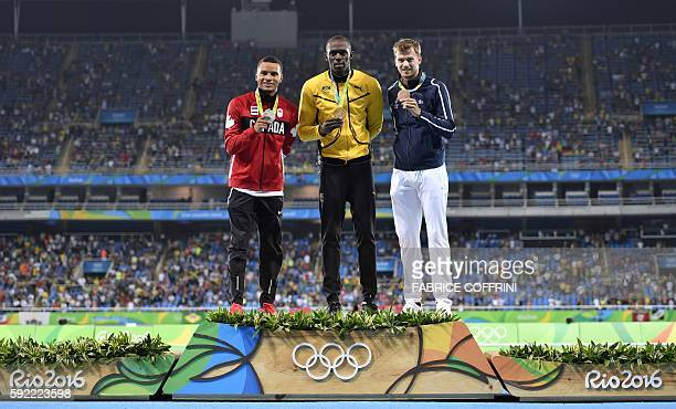 Canada's Andre de Grasse Jamaica's Usain Bolt and France's Christophe Lemaitre pose during the podium ceremony for the Men's 200m during the...