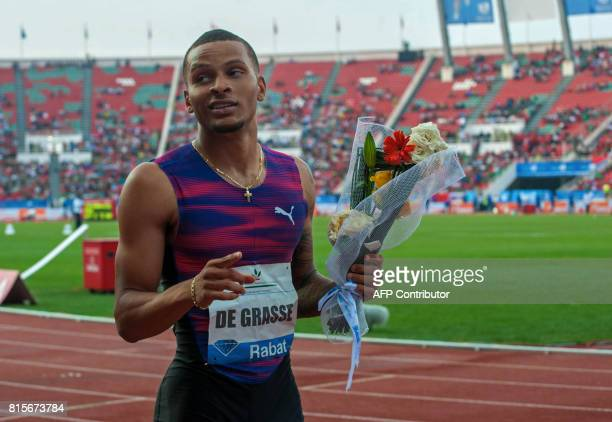 Canada's Andre De Grasse reacts after winning the 200m race at the IAAF Diamond League Mohammed VI Athletics meeting in Rabat on July 16 2017 / AFP...