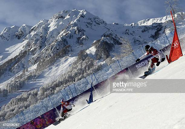 Canada's Ariane Lavigne and Canada's Caroline Calve compete in the Women's Snowboard Parallel Giant Slalom qualification run at the Rosa Khutor...