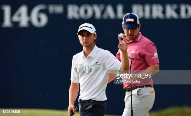 Canada's Austin Connelly reacts after holing a putt on the 18th green during his third round on day three of the Open Golf Championship at Royal...