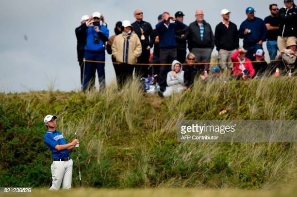 Canada's Austin Connelly watches his approach shot from the 9th fairway during his final round on day four of the 2017 Open Golf Championship at...